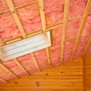 Fibreglass insulation installed in the sloping ceiling of a timber house. More building a home:- [url=http://www.istockphoto.com/file_search.php?action=file&lightboxID=4734429]here[/url].